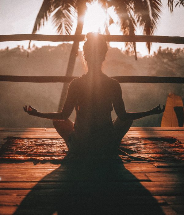 A silhouette of a woman meditating