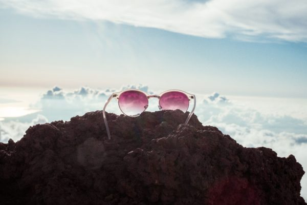 Ruby colored glasses on top of a mountain