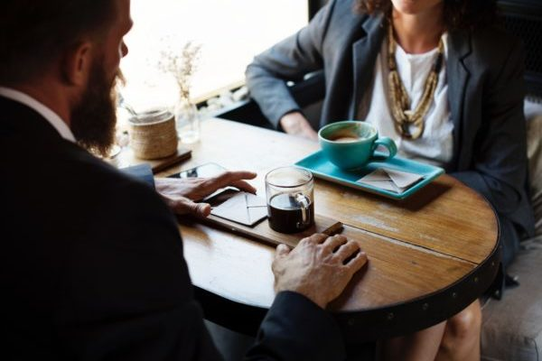 Picture of two person meeting in a coffee shop