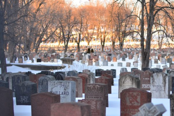 Picture of gravestones in a snowy graveyard