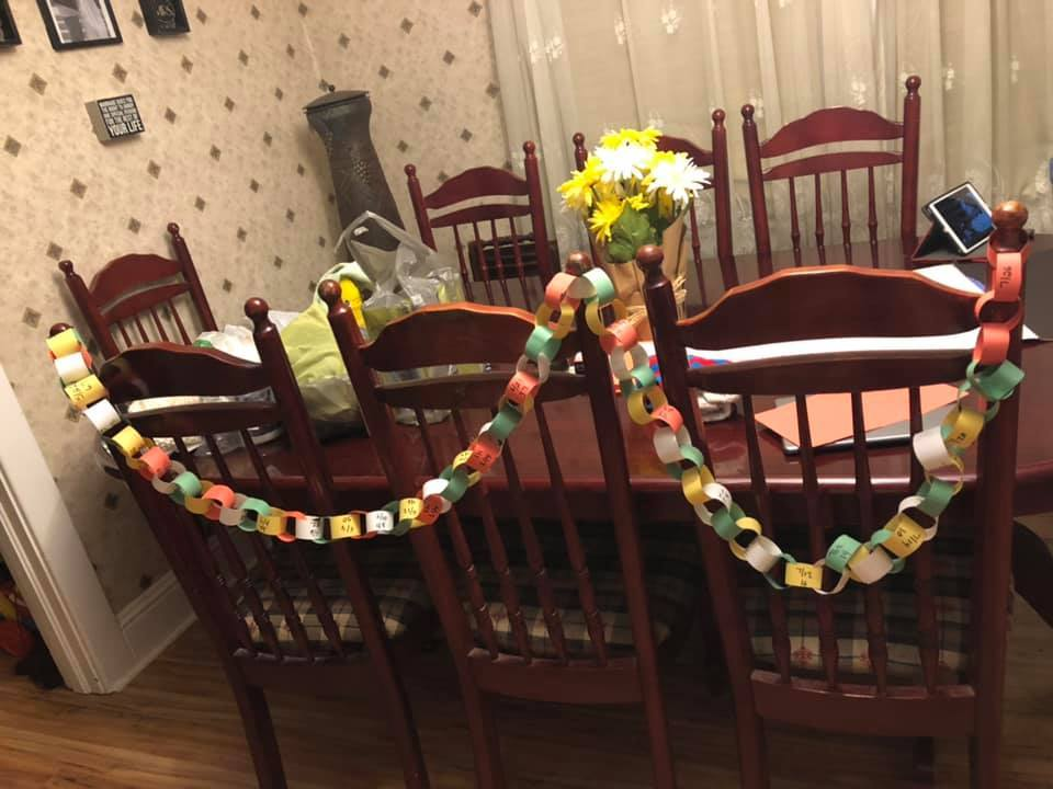 Picture of a decor placed on chairs in the dining room