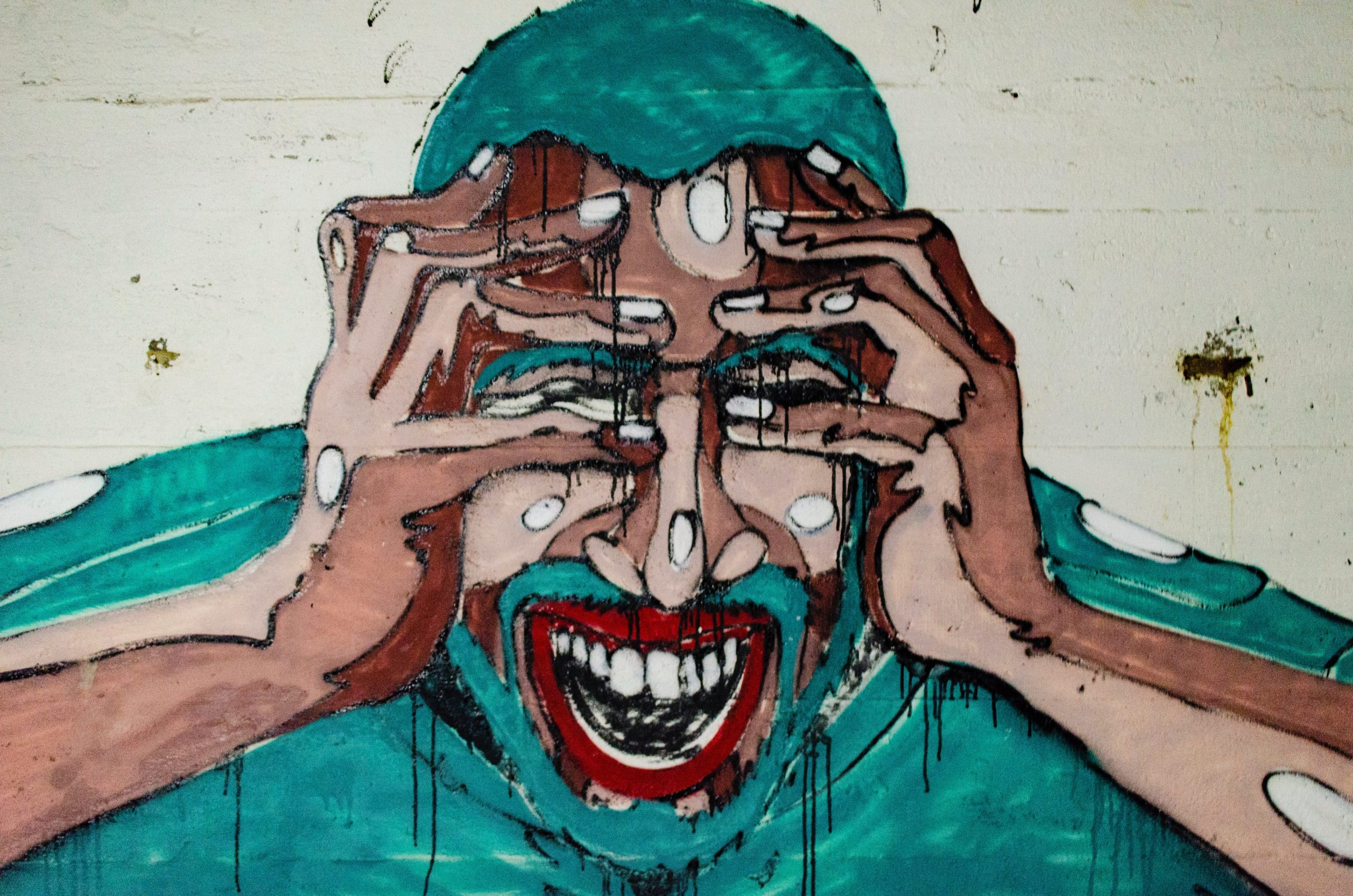Picture of a graffiti art on a gray wall