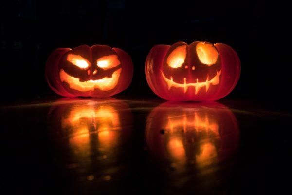 Two lit Halloween pumpkins