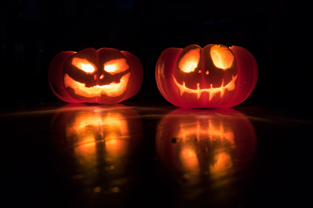 Two lit Halloween pumpkins