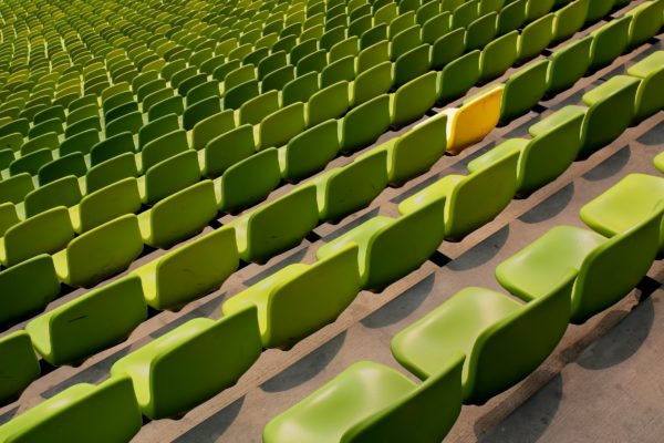 Picture of green seats of a stadium