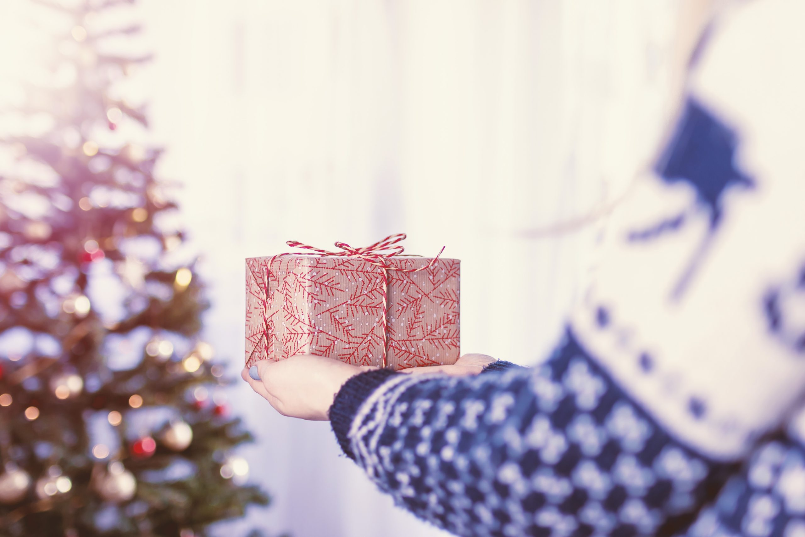 A red gift being held by a person