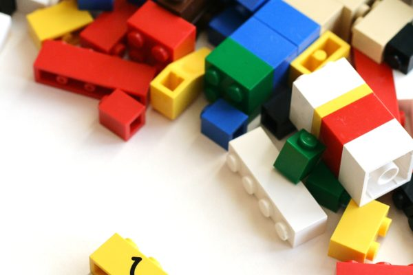 Picture of a handful of legos scattered on the floor