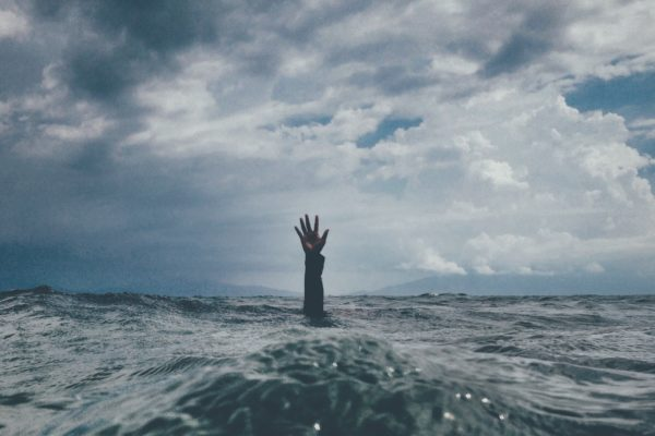 Picture of a raised hand from under the sea
